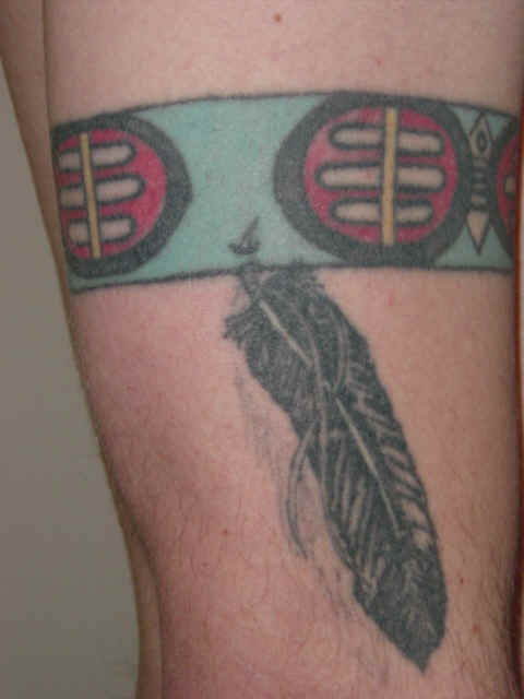Brian's tattoo on left arm Brian's tribal tattoo on his right arm